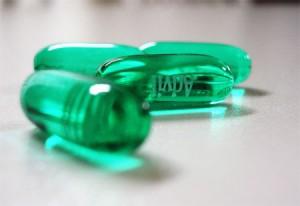 Closeup of four green Advil pills