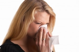 allergies woman blowing nose