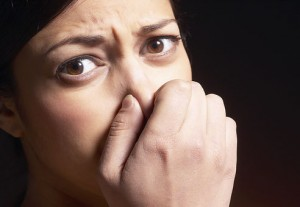 bad breath person holding nose