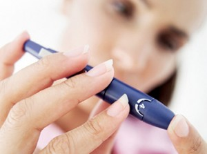 high blood sugar and hyperglycemia; woman checking blood sugar