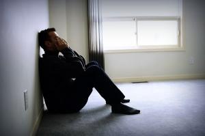 Sad man sitting on floor