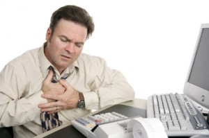 Man with heartburn holding chest